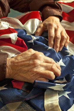 Hands on American flag