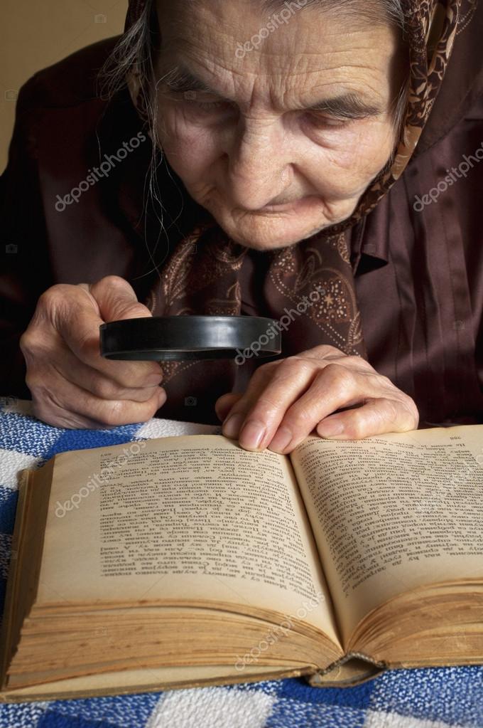 Eldery woman reading Bible