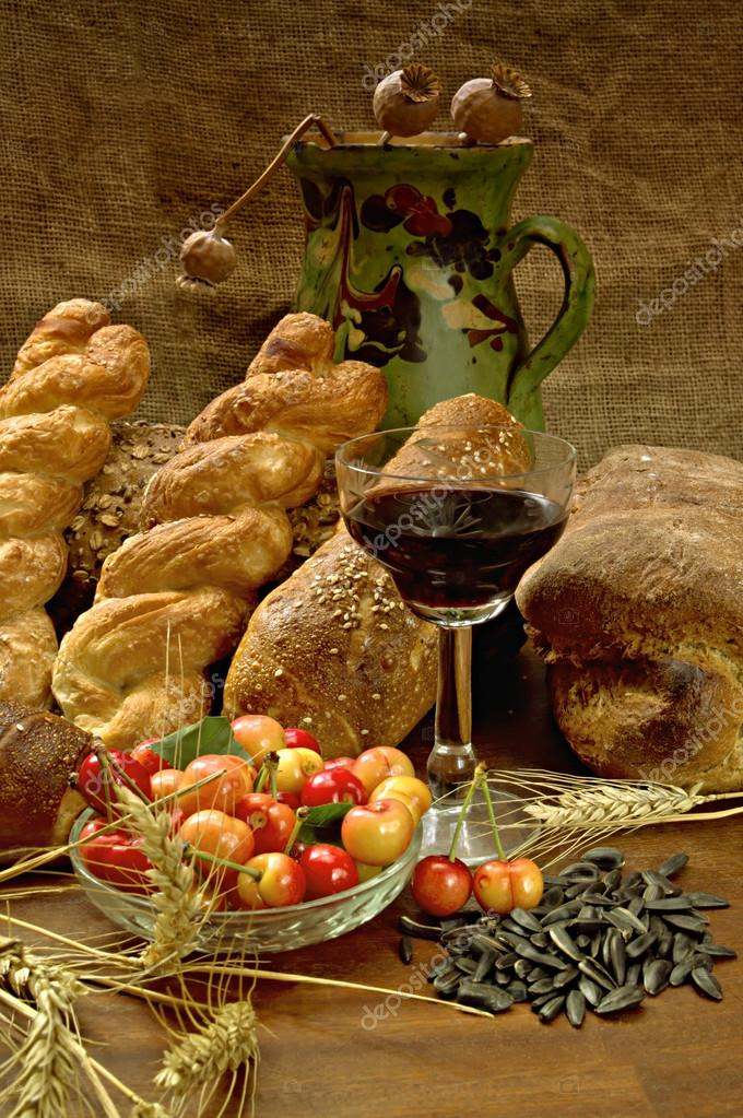 Still life with bread, cherrys, and wine