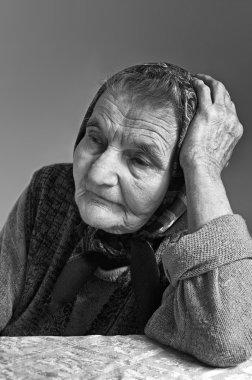 Portrait of sad lonely pensive old senior woman.