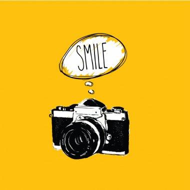 Vintage photo camera says 'SMILE' vector design