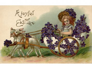 A vintage Easter postcard of a girl riding in a wagon full of vi