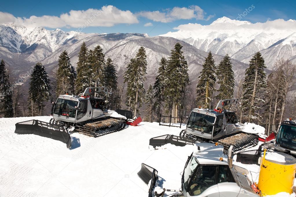 Snowplows, montains on background