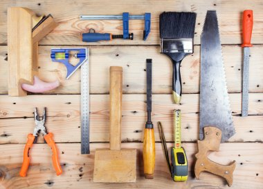 Kit of construction tools and instruments on wood texture backgr