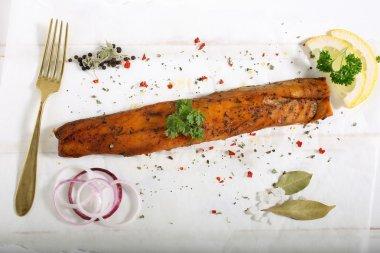 Smoked fish on ceramic plate