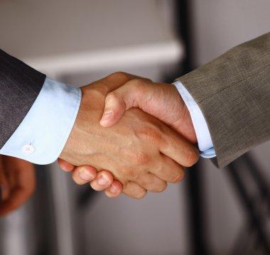 Handshake isolated on business background