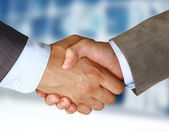 Photo Closeup of a business hand shake between two colleagues
