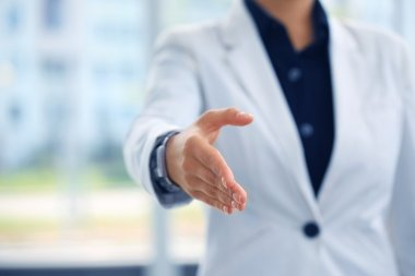 Midsection of a businesswoman with an open hand ready to seal a deal