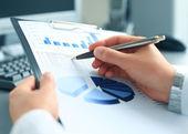 Photo Stock market graphs monitoring