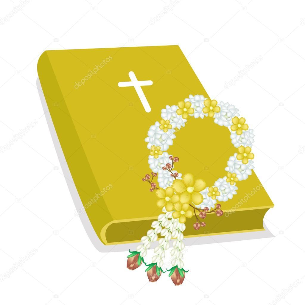 Santa Biblia con Cruz de madera y guirnalda de flores — Archivo ...