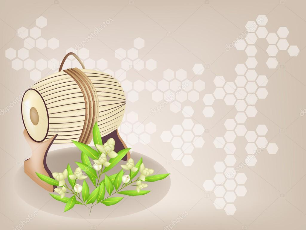 Sampho Drum and Ylang Ylang Flowers on Brown Background