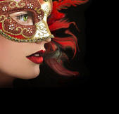 Profile of woman in mask.