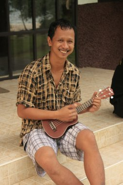 Thai man playing mandolin