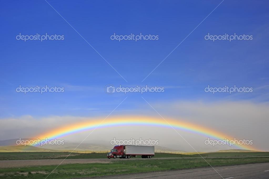 Rainbow over highway