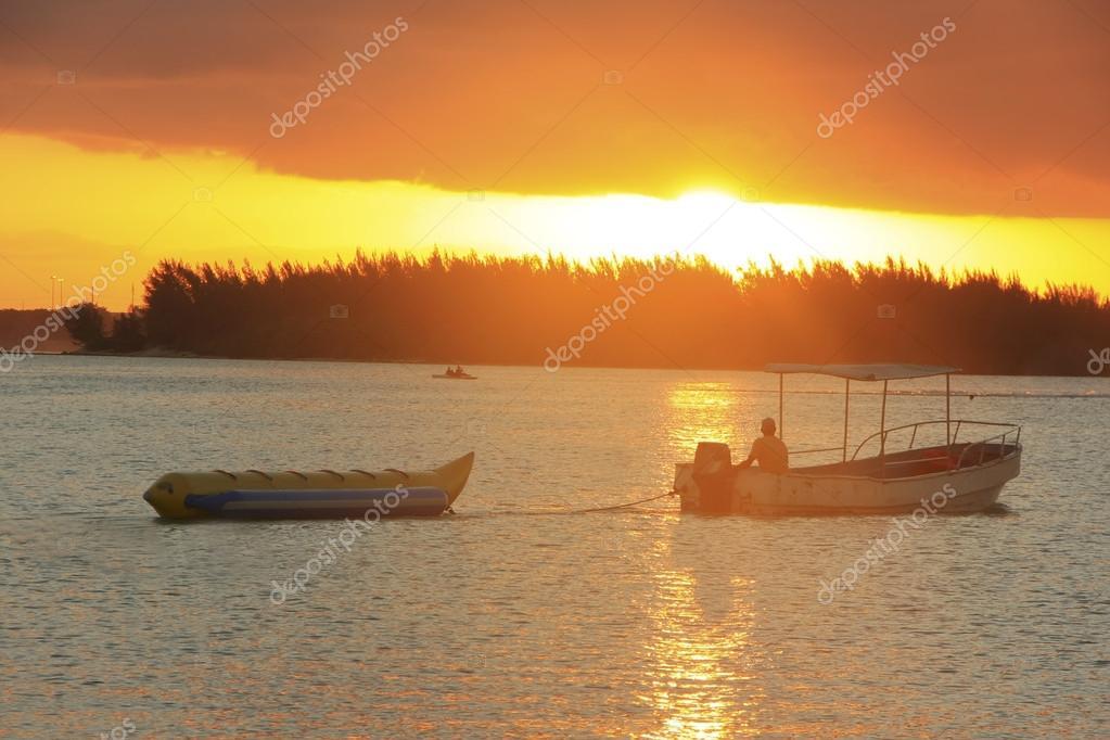 Banana boat in Boca Chica bay at sunset