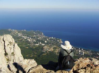 Young woman enjoying view from Ai-Petri summit, Crimea