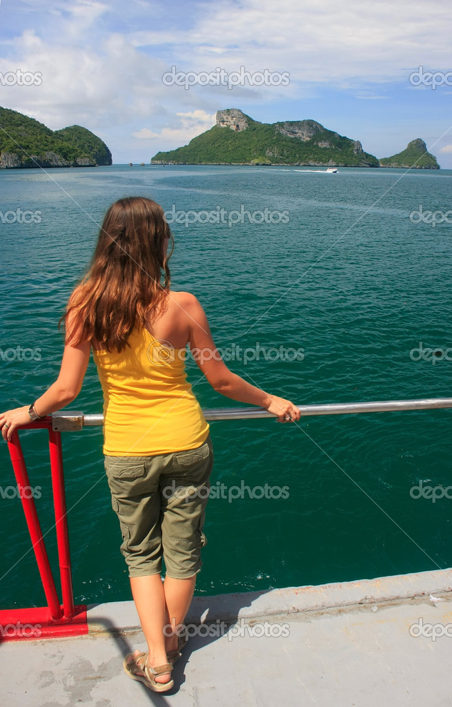 Young woman admiring scene from a boat, Ang Thong National Marin