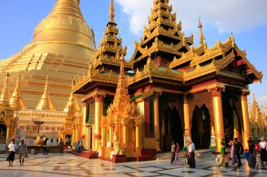 Pilgrims walking around Temples of Shwedagon Pagoda complex, Yan