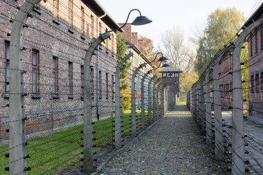 OSWIECIM, POLAND - OCTOBER 22: Electric fense in Auschwitz I, a former Nazi extermination camp on October 22, 2012 in Oswiecim, Poland. It was the biggest nazi concentration camp in Europe.