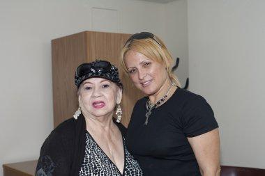 Blanca Iris Villafane and Mayra Roman visit Yomo Toro at hospita