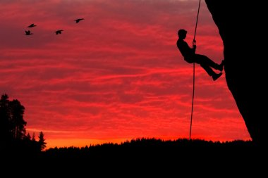 Rock Climber Rappelling Silhouette