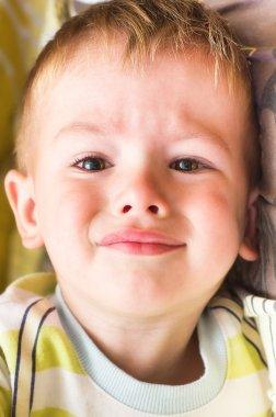 Plaintive portrait of cute little boy