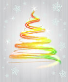 Shiny red yellow green christmas tree flare concept in snowfall