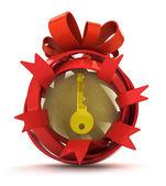 otevřel červenou stužku dar koule se zlatým klíčem uvnitř
