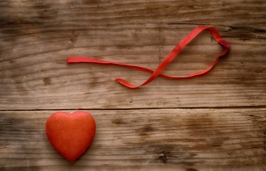 Symbol of heart on a wooden background