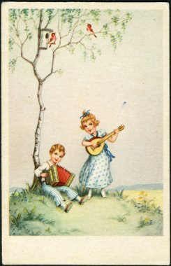 German postcard. Depicts a girl and a boy playing a musical instrument, circa 1930.