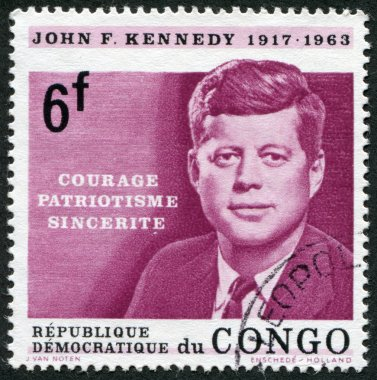 A stamp printed in the Democratic Republic of the Congo, is dedicated to the anniversary of the death of U.S. President John Kennedy, circa 1964