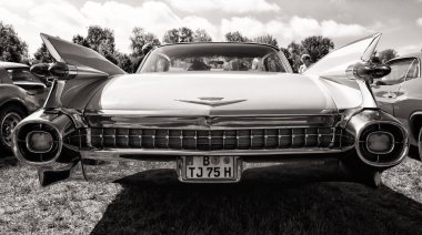 Full-size luxury car Cadillac Sixty Special Fleetwood, rear view, black and white