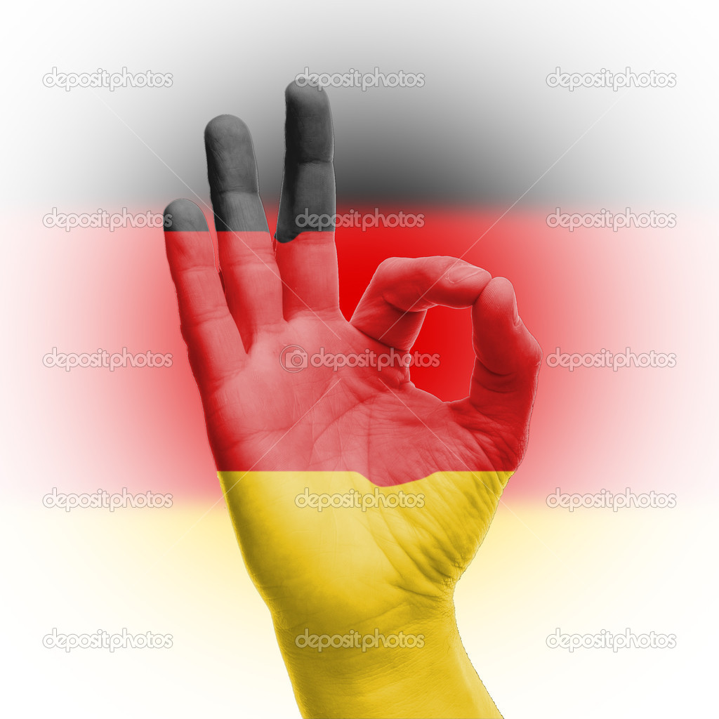 hand ok sign with german flag u2014 stock photo ijdema 18985651