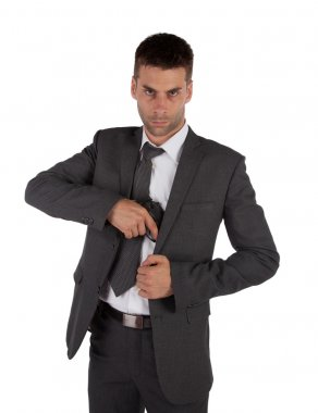 Man in a suit grabbing gun