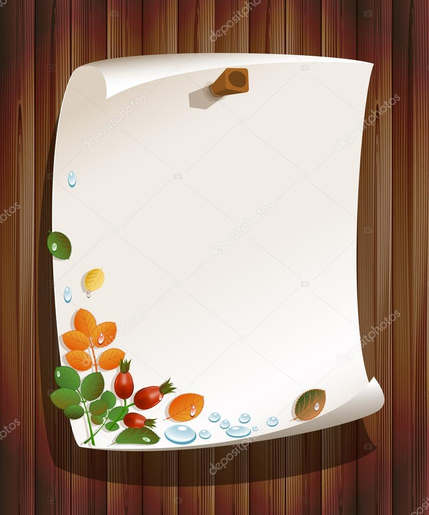 Autumn leaves with rose-hips and paper board on wood background