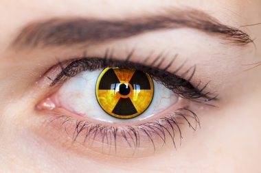 Human eye with radiation symbol.