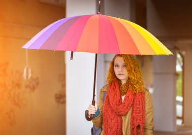 Redhead girl with umbrella.