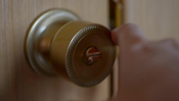 Hand opens the door.