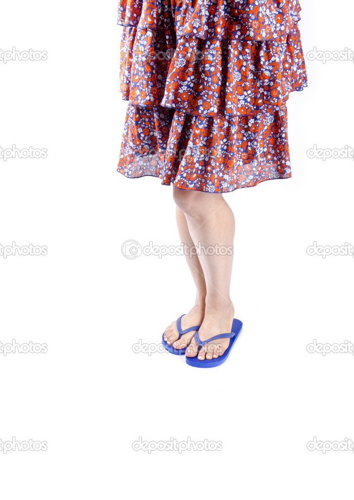 8856bc84f Woman Wearing Floral Skirt and Pink Flip Flops Isolated on White — Stock  Photo