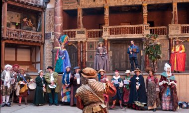 Performers in traditional costume in Shakespeare's Globe Theatre