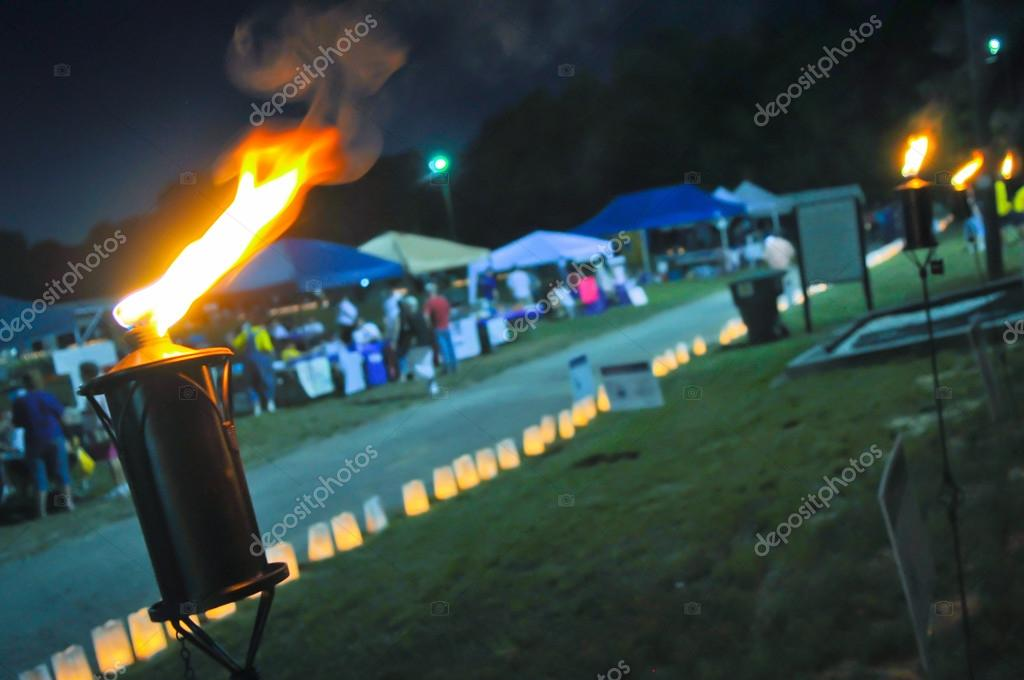 Burning torches at event