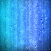 Blue rainy window background with drops and blur