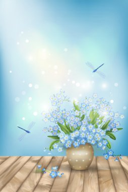Spring blue flowers dragonflies on wood background