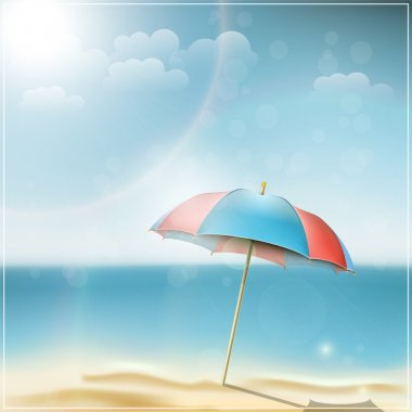Summer day on ocean beach with umbrella