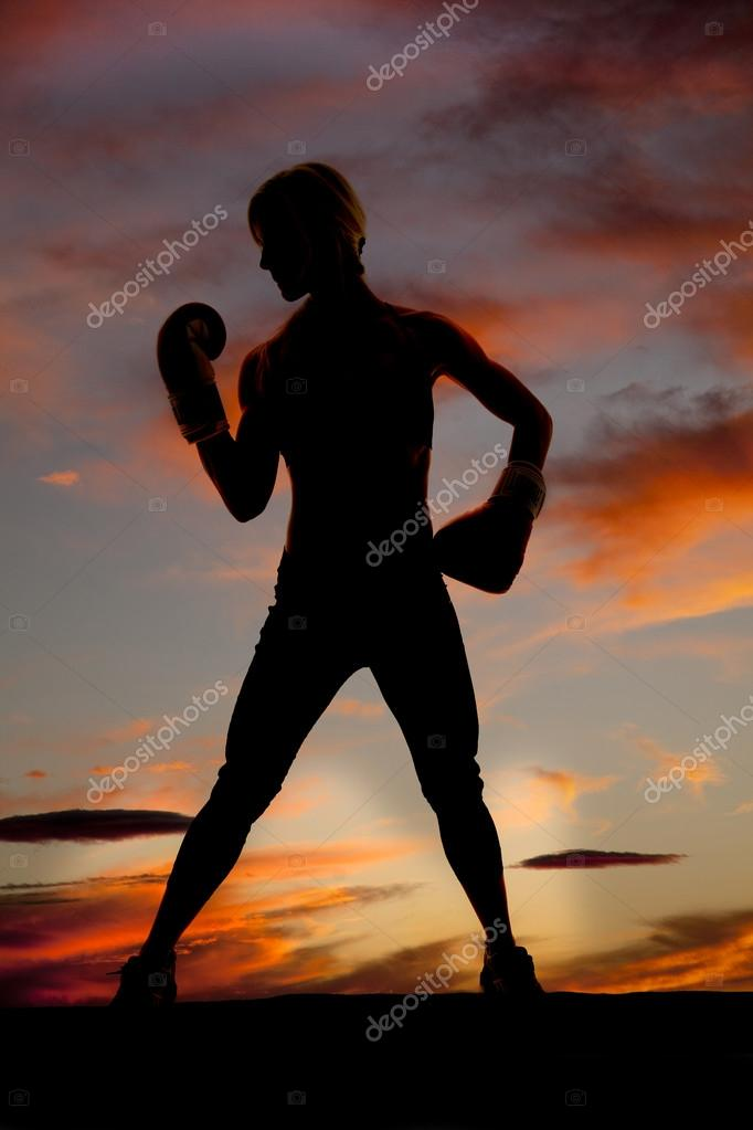 Silhouette boxer look at hand