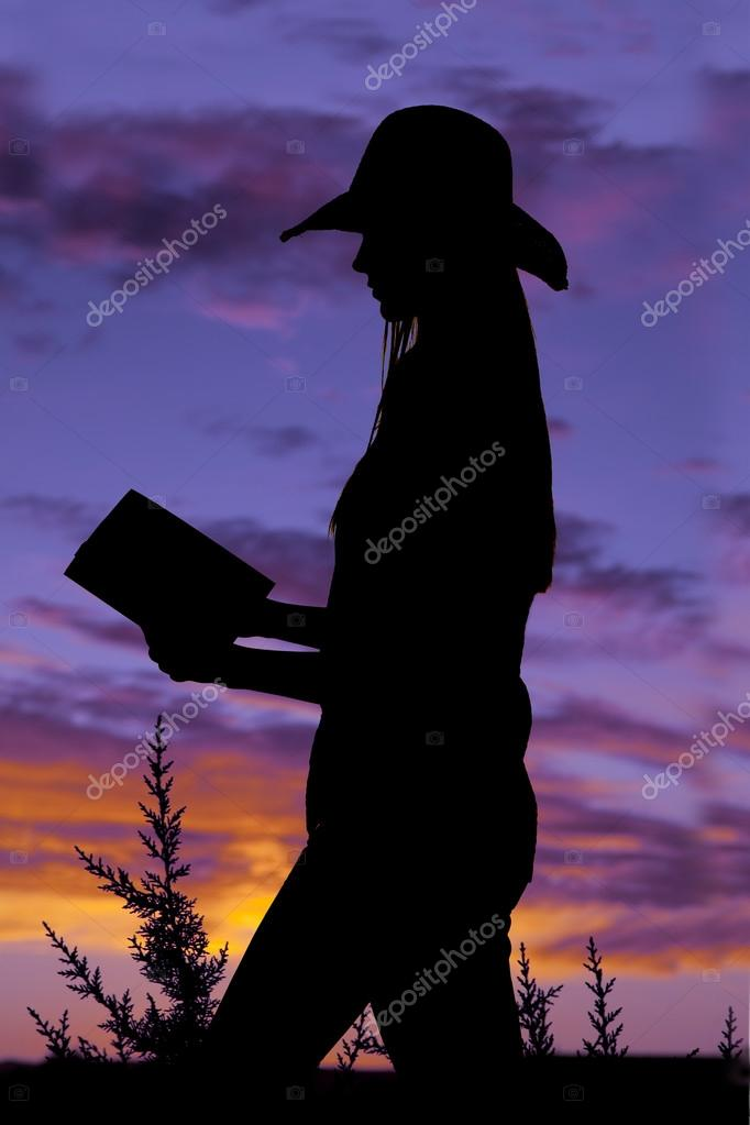 standing reading book silhouette