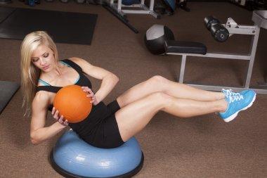 woman fitnes ball twist look down