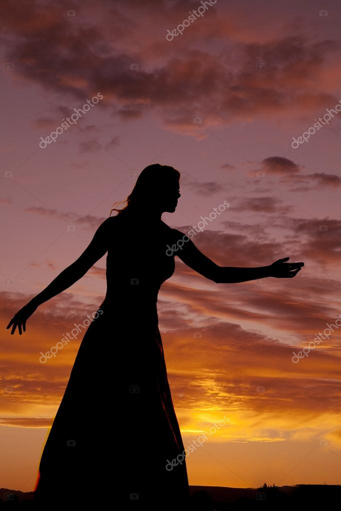 woman in sunset reaching
