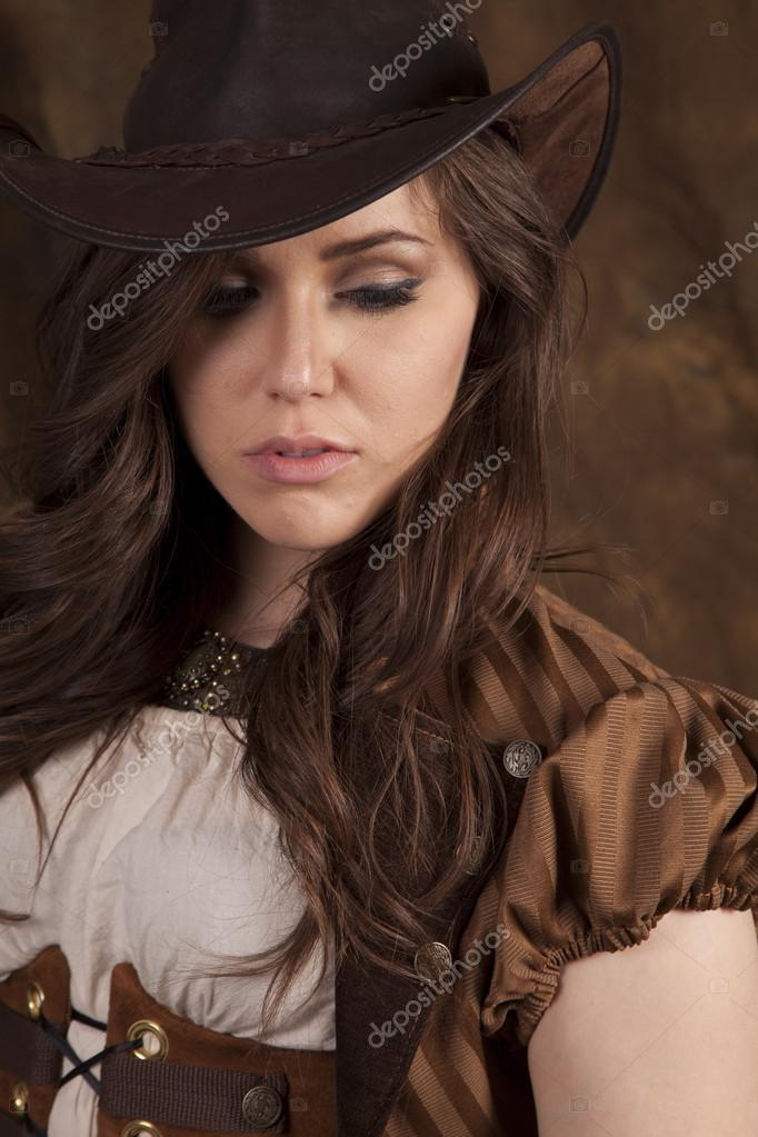 Cowgirl looking down
