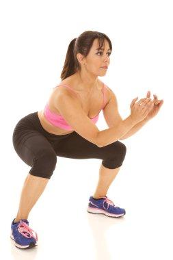 Fitness woman pink sports bra squat